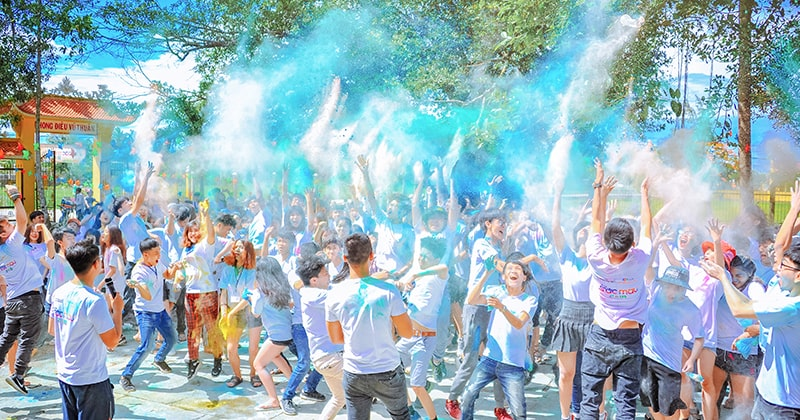 Summer camp event with children throwing coloured powder