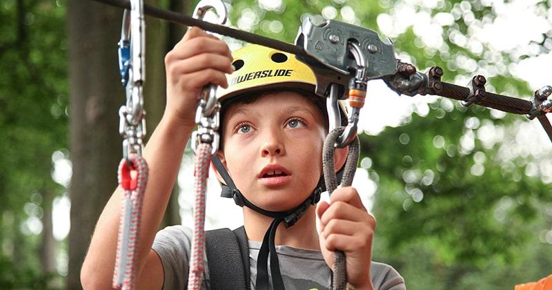 Child preparing for zipline activity